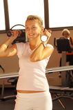 The woman in fitness centre Stock Images