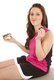 Woman fitness donut eat. A woman is eating a bite of a donut Stock Photos