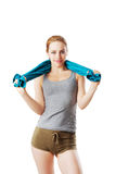 Woman in fitness dress with blue towel over her shoulder. Isolated on white Royalty Free Stock Images