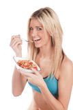 Woman fitness eating cereal Royalty Free Stock Photography
