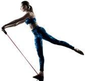 Woman fitness elastic  excercises silhouette Stock Photo