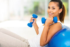 Woman fitness exercise. Beautiful young woman doing fitness exercise at home Stock Image