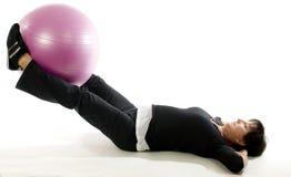 Woman fitness exercise leg raise  training ball. Middle age senior woman exercising leg raise abdominal exercise with core training ball Stock Photos
