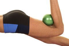 Woman fitness green ball behind knee close Royalty Free Stock Photo