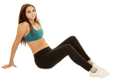 Woman fitness green sports bra sit legs out Stock Photography