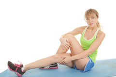 Woman fitness green top sit Royalty Free Stock Images