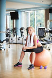 Woman in fitness gym drink water Royalty Free Stock Photos