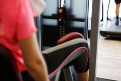 Woman at the fitness gym exercising Royalty Free Stock Image