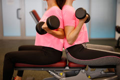 Woman at the fitness gym exercising Royalty Free Stock Photography