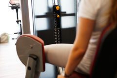 Woman at the fitness gym exercising Royalty Free Stock Photos