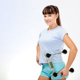 Woman in fitness holding scales Royalty Free Stock Photography