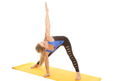 Woman fitness holy pants stretch arm up Royalty Free Stock Photos