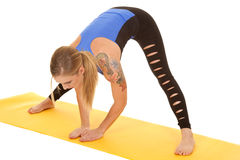 Woman fitness holy pants stretch forward Royalty Free Stock Photo
