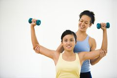 Woman and fitness instructor Royalty Free Stock Photography