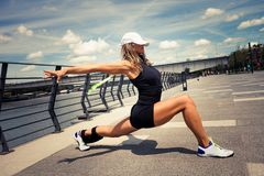 Woman fitness instructor doing training summer day city promenad Stock Photography