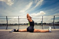 Woman fitness instructor doing training summer day city promenad Stock Photos