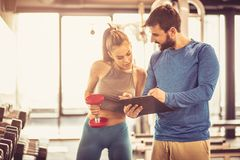 Planning exercise. Couple at gym.