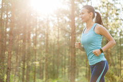 Woman fitness jogging workout in nature, wellness concept. Stock Photography