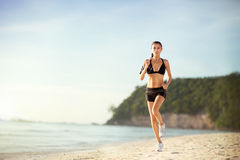 Woman fitness jogging workout wellness concept. Royalty Free Stock Images