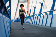 Woman fitness model running. Sport lifestyle. Royalty Free Stock Images