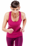 Woman in fitness outfit running, isolated over white background. Isolated over white background Stock Photo
