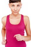 Woman in fitness outfit running, isolated over white background. Portrait Stock Photos