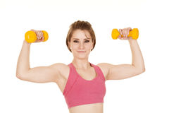 Woman fitness pink bra yellow weights flex close Royalty Free Stock Photography