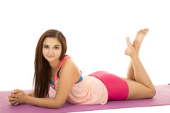 Woman fitness pink lay on stomach legs up Stock Photos