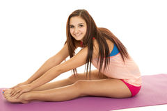 Woman fitness pink sit side stretch out Stock Photo