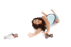 Woman fitness reach for chocolate Stock Photo