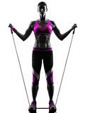 Woman fitness resistance bands exercises silhouette Royalty Free Stock Photos