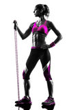 Woman fitness resistance bands exercises silhouette Stock Images