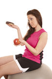 Woman fitness sad donut apple Royalty Free Stock Photo