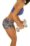 Woman fitness shorts and bra weights side body lean over Stock Image