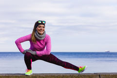 Woman fitness sport girl training outdoor in cold weather Stock Photos
