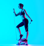 Woman fitness Stepper exercices isolated Stock Images
