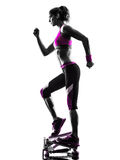 Woman fitness stepper exercises silhouette Royalty Free Stock Photo