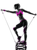 Woman fitness stepper resistance bands exercises silhouette. One caucasian woman exercising stepper resistance bands fitness in studio silhouette isolated on Stock Photo