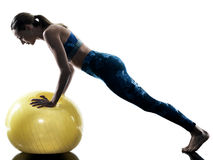 Woman fitness  swiss ball excercises silhouette Royalty Free Stock Images