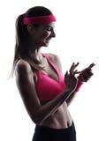 Woman fitness telephone smartphone  silhouette Stock Photo