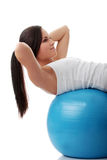 Woman during fitness time with ball Stock Photo