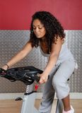 Woman fitness trainer on bicycle Royalty Free Stock Photos