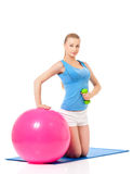 Woman in fitness wear exercising with fitness-ball Royalty Free Stock Photo