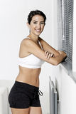 Woman in fitness wear at home Royalty Free Stock Images