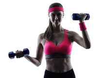 Woman fitness weights training exercises silhouette Stock Photography