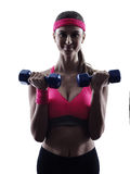 Woman fitness weights training exercises silhouette Stock Photo