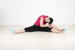 Woman fitness on white laminate flooring royalty free stock image