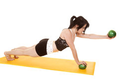Woman fitness yellow mat balls push up hold out Stock Photo
