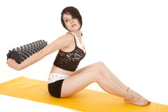 Woman fitness yellow mat behind back roll Stock Photography