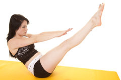 Woman fitness yellow mat legs arms up Stock Photography